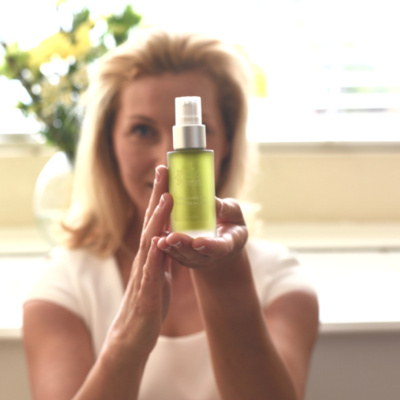 Lady holding Cleanser
